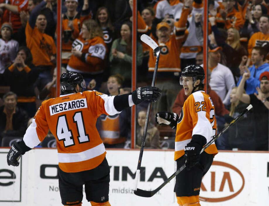 Philadelphia Flyers' Luke Schenn, right, and Andrej Meszaros celebrate after Schenn's goal during the third period of an NHL hockey game against the New York Rangers, Sunday, March 2, 2014, in Philadelphia. Philadelphia won 4-2. (AP Photo/Matt Slocum)