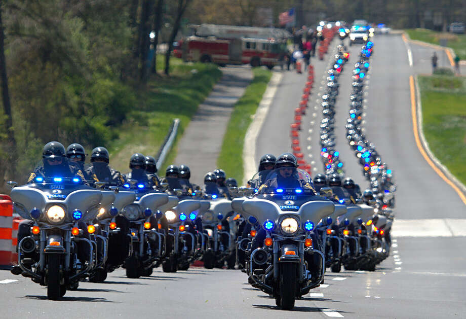 A procession of motorcycles lead a procession for Virginia Trooper Chad P. Dermyer in York Co., Va. on Tuesday, April 5, 2016. Dermyer was killed in the line of duty at the Richmond Greyhound bus station last week. (Joe Fudge /The Daily Press via AP) MANDATORY CREDIT