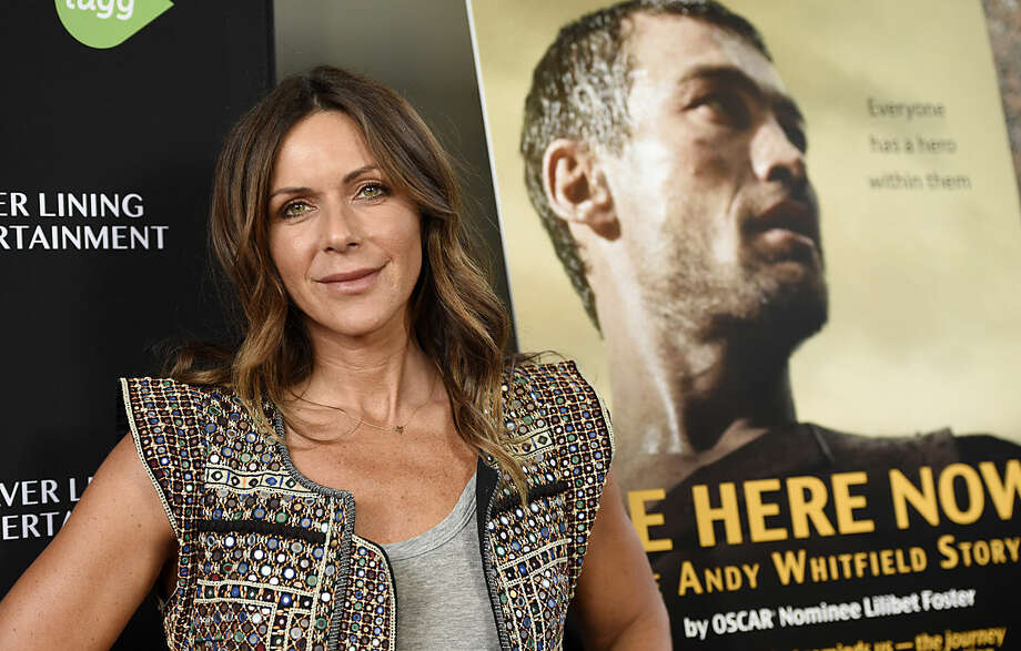 """Vashti Whitfield, widow of actor Andy Whitfield, poses at the premiere of the film """"Be Here Now (The Andy Whitfield Story),"""" at the UTA Theater on Tuesday, April 5, 2016, in Beverly Hills, Calif. Andy Whitfield died of non-Hodgkin lymphoma in 2011. (Photo by Chris Pizzello/Invision/AP)"""