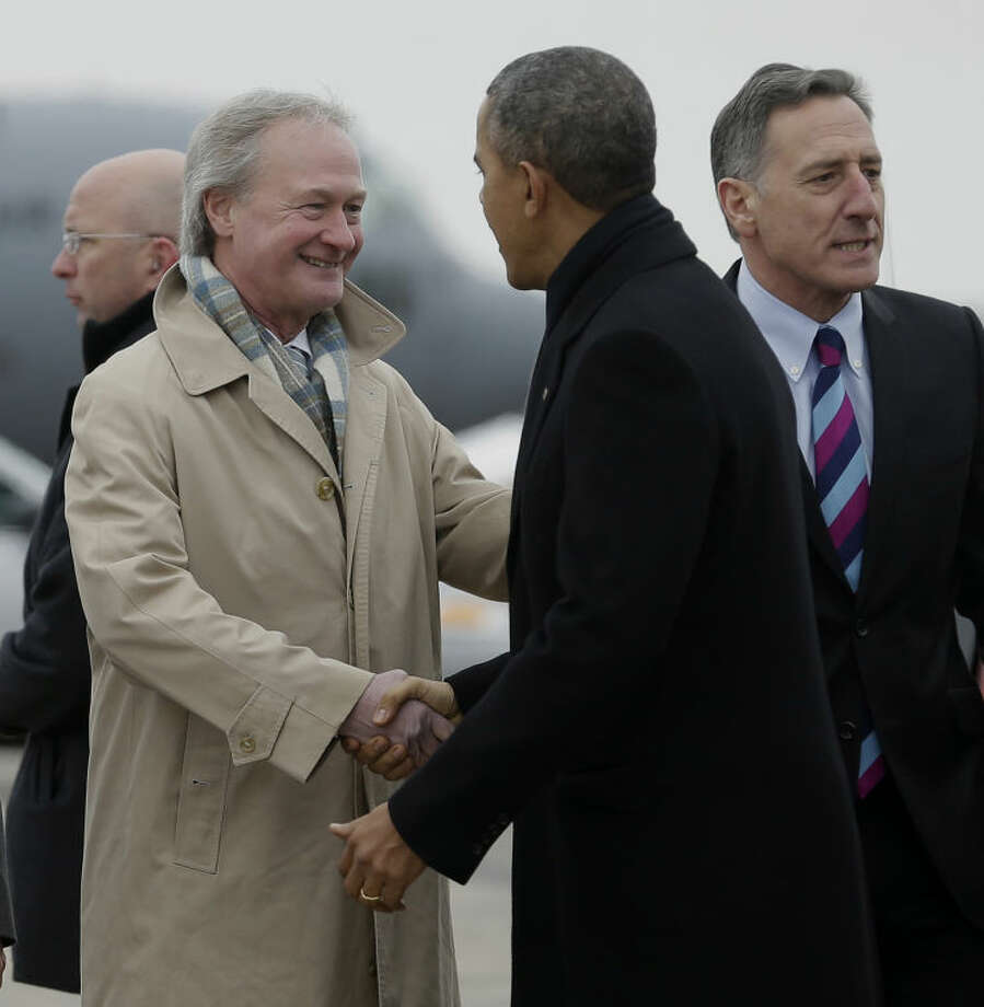 Rhode Island Gov. Lincoln Chafee greets President Barack Obama on the tarmac upon his arrival on Air Force One at Bradley Air National Guard Base in East Granby, Conn., Wednesday, March 5, 2014. Obama traveled to Hartford, Conn., area to highlight the importance of raising the minimum wage and then will travel to Boston for a pair of Democratic fundraising. Vermont Gov. Peter Shumlin is at right. (AP Photo/Pablo Martinez Monsivais)