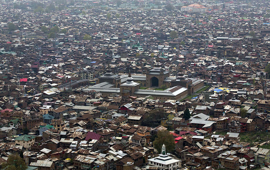 A view of Srinagar, the main city of Indian controlled Kashmir, as seen from the 18th century Hari Parbat Fort situated atop a hill, Tuesday, April 5, 2016. Kashmir, known for its mountains, lakes, forests and moderate weather, was one of Asia's most popular tourist destinations until a Muslim separatist rebellion broke out in the region at the end of 1989 which according to officials has claimed more than 60,000 lives. With the situation improving, many tourists have started returning to Kashmir. (AP Photo/Dar Yasin)