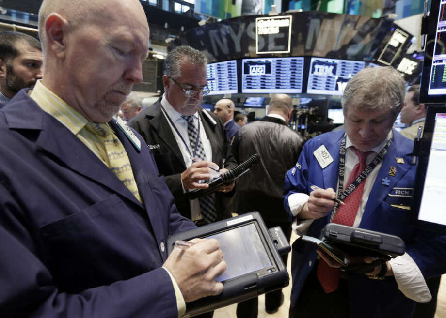 Traders work on the floor of the New York Stock Exchange, Tuesday, March 4, 2014. Relieved investors sent stocks sharply higher Tuesday after Russia pulled troops back from the border of Ukraine. The rally erased steep losses from Monday caused by fears an escalating conflict. (AP Photo/Richard Drew)