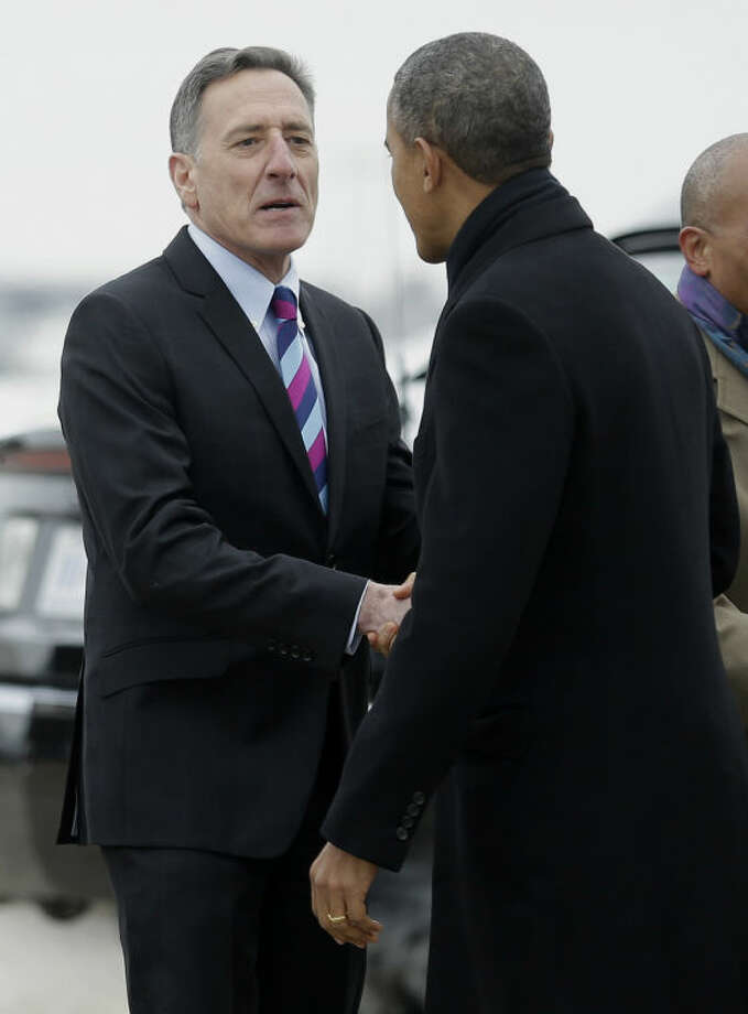 Vermont Gov. Peter Shumlin greets President Barack Obama on the tarmac upon his arrival on Air Force One at Bradley Air National Guard Base in East Granby, Conn., Wednesday, March 5, 2014. Obama traveled to the Hartford, Conn., area to highlight the importance of raising the minimum wage and then will travel to Boston for a pair of Democratic fundraising. (AP Photo/Pablo Martinez Monsivais)