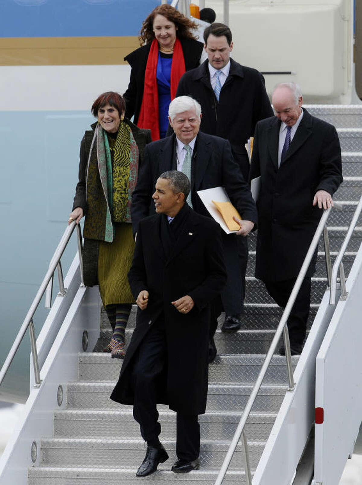 President Barack Obama, followed by Rep. John Larson, D-Conn., Rep. Rosa DeLauro, D-Conn., Rep. Joe Courtney, D-Conn., Rep. Jim Himes, D-Conn., and Rep. Elizabeth Esty, D-Conn., arrive on Air Force One at Bradley Air National Guard Base, Wednesday, March 5, 2014, in East Granby, Conn. Obama is in Connecticut to talk about increasing the federal minimum wage. (AP Photo/Jessica Hill)