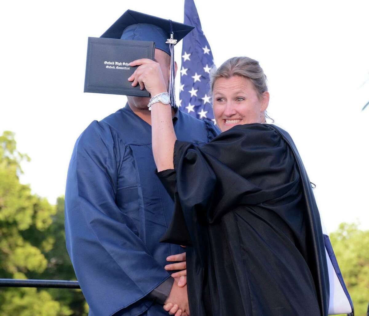 Oxfords Principal, Dorothy Potter, teases graduate Aaron Trelease as he receives his diploma during Oxford High Schools Graduation ceremony in Oxford, Conn. that was held on Friday June 10, 2016.
