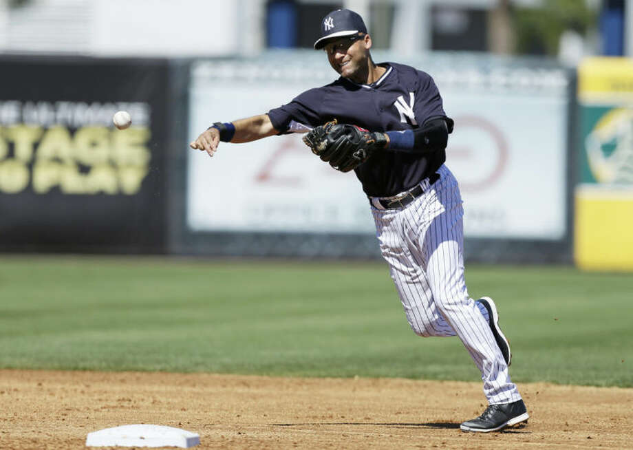 New York Yankees shortstop Derek Jeter throws to first base to put out Washington Nationals' Eury Perez during the third inning of an exhibition baseball game Monday, March 3, 2014, in Tampa, Fla. (AP Photo/Charlie Neibergall)