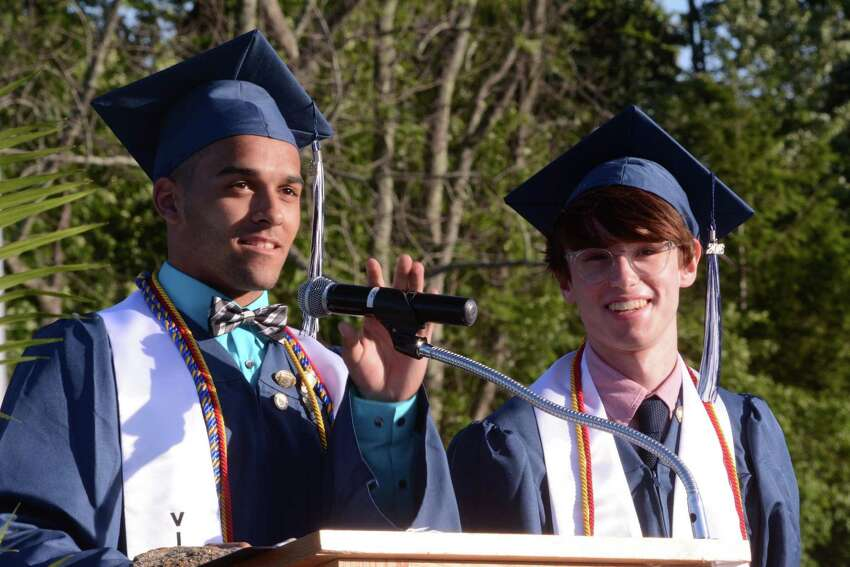 Matt Dodson, Class Vice President, left, and Zac Kerwin, Class Treasurer present the Class gift to the school. Oxford High Schools Graduation in Oxford, Conn. was held on Friday June 10, 2016.