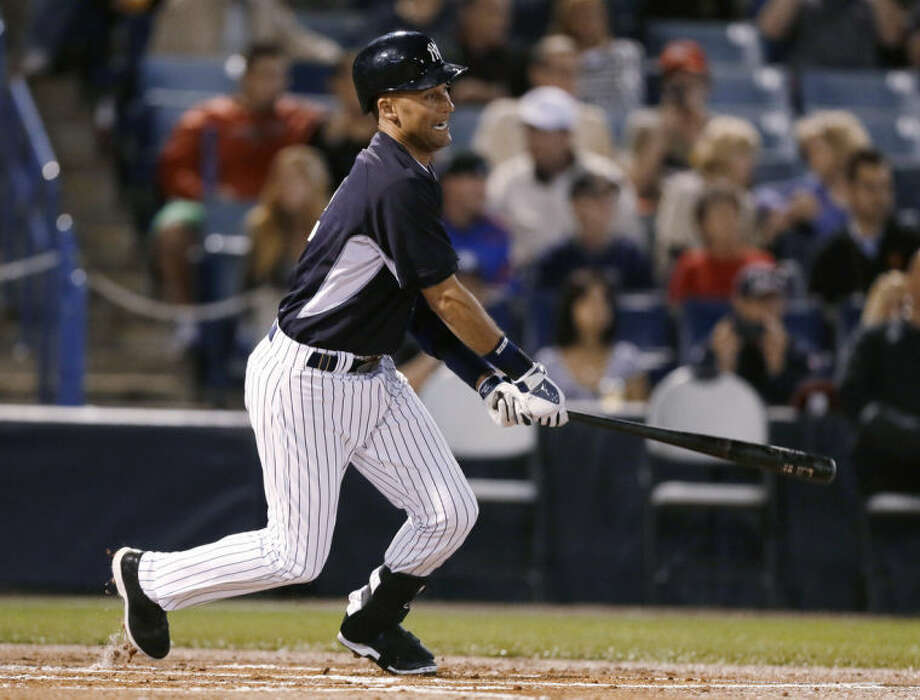 New York Yankees designated hitter Derek Jeter grounds out during the first inning of the Yankees' exhibition baseball game against the Baltimore Orioles on Tuesday, March 4, 2014, in Tampa, Fla. (AP Photo/Charlie Neibergall)