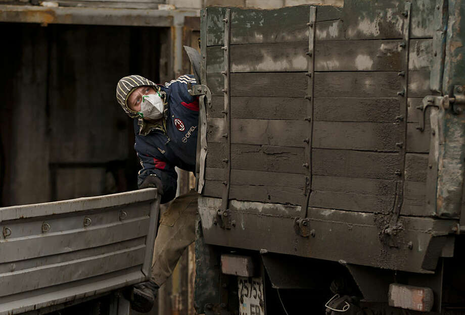 An Ukrainian coal miner climbs in the back of a truck loaded with 6 bodies of colleagues killed in an explosion yesterday before dawn at more than 1,000 metres (3,200 feet) underground at the Zasyadko mine, in Donetsk, Ukraine, Thursday, March 5, 2015. Officials in a separatist rebel-held city in east Ukraine say the death toll from an accidental explosion at a coal mine has risen to 32, while one person still remains unaccounted for. (AP Photo/Vadim Ghirda)