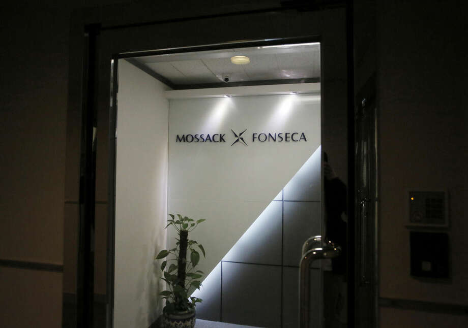 FILE - This April 5, 2016 file photo shows the entrance of the regional head office of Panama-based law firm Mossack Fonseca, one of the world's biggest creators of shell companies, in Hong Kong, America's openness to foreign tax evaders is coming under new scrutiny after the leak this week of 11.5 million confidential documents from the Panamanian law firm. The Panama Papers show how some of the world's richest people hide assets in shell companies to avoid paying taxes. (AP Photo/Vincent Yu)