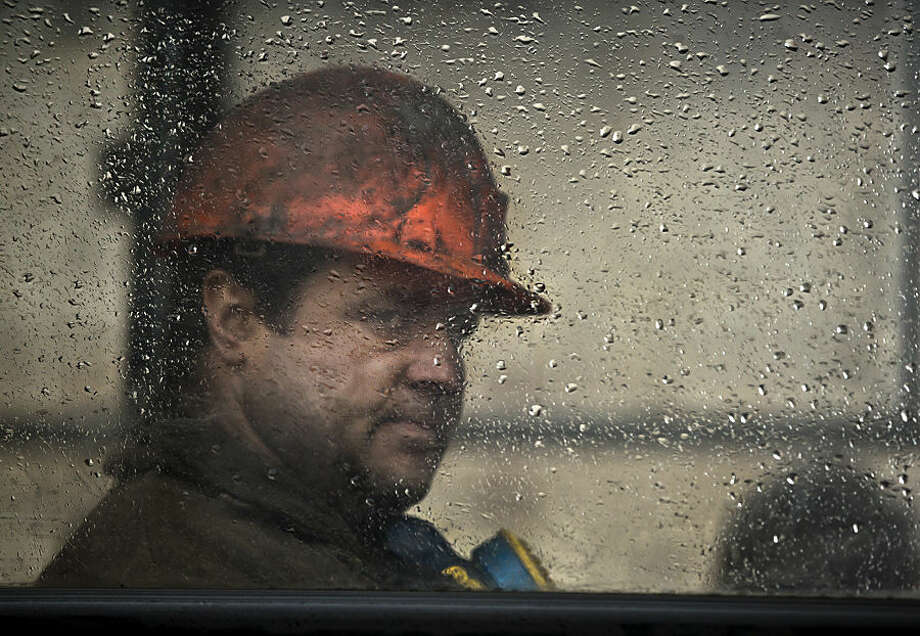 A Ukrainian coal miner sits inside a bus after exiting the underground of the Zasyadko mine in Donetsk, Ukraine, Wednesday, March 4, 2015. An explosion ripped through a coal mine before dawn Wednesday in war-torn eastern Ukraine, killing at least one miner and trapping more than 30 others underground, rebel and government officials said. One injured miner reported seeing five bodies. (AP Photo/Vadim Ghirda)