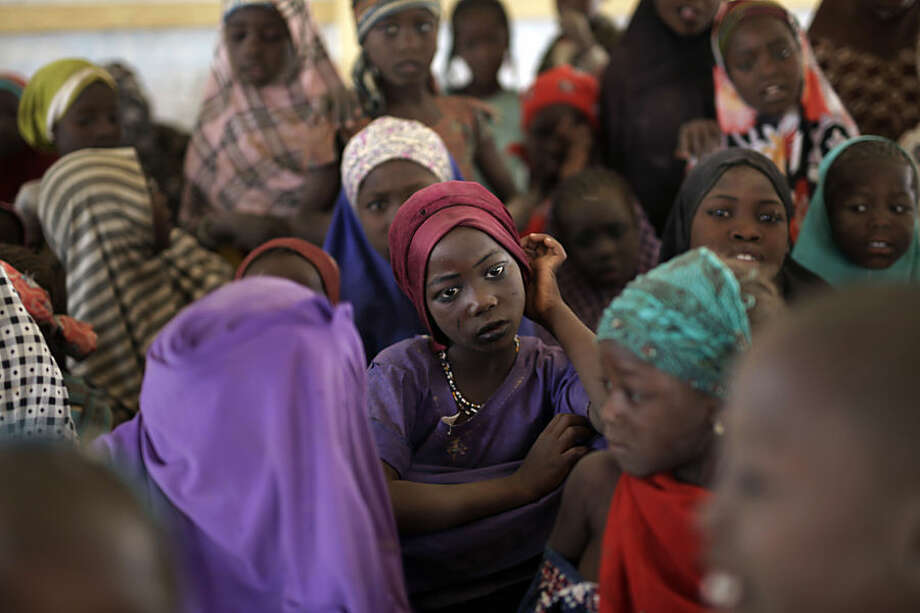 Nigerian girls who fled Boko Haram to Chad gather in a school set up by UNICEF at the Baga Solo refugee camp in Chad, Wednesday March 4, 2015. The camp, jointly run by the Chadian government and UNHCR, opened mid-January 2015 and hosts over 6000 refugees. Officials say that several thousand had arrived in Chad by the end of 2015 as Boko Haram intensified its attacks in the area. After the Baga massacre, another 15,000 came bringing the total now to about 18,000, Chadian authorities believe there are more than 2,000 others still trapped on islands, awaiting transport to the safety of a refugee camp though there are more arriving each day in one of the poorest countries on Earth(AP Photo / Jerome Delay)
