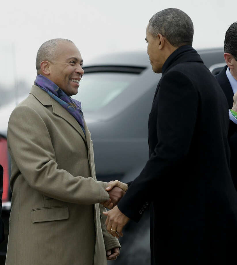 Massachusetts Gov. Deval Patrick greets President Barack Obama upon his arrival on Air Force One at Bradley Air National Guard Base in East Granby, Conn., Wednesday, March 5, 2014, before the president traveled to the Hartford, Conn. area to highlight the importance of raising the minimum wage and then will travel to Boston for a pair of Democratic fundraising. (AP Photo/Pablo Martinez Monsivais)