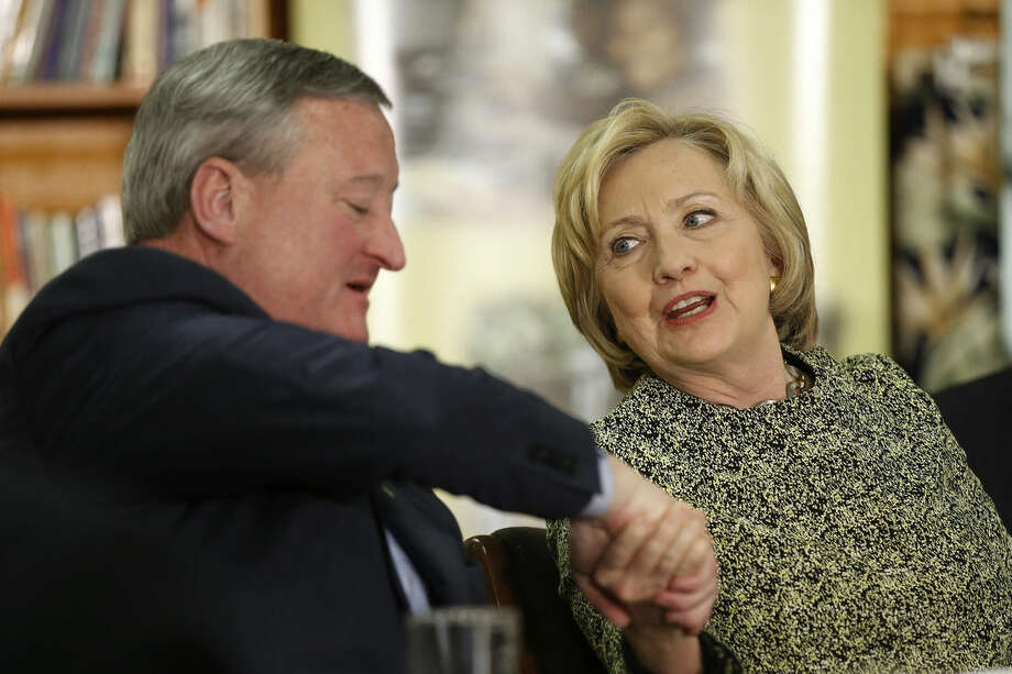 Democratic presidential candidate Hillary Clinton shakes hands with Philadelphia Mayor Jim Kenney, Wednesday, April 6, 2016, at Impact Services in Philadelphia. (AP Photo/Matt Rourke)