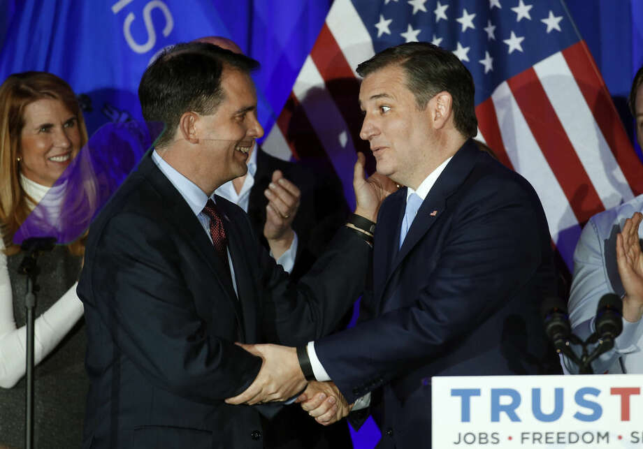 Republican presidential candidate Sen. Ted Cruz, R-Texas, right, shakes hands with Wisconsin Gov. Scott Walker during a primary night campaign event, Tuesday, April 5, 2016, in Milwaukee. (AP Photo/Paul Sancya)