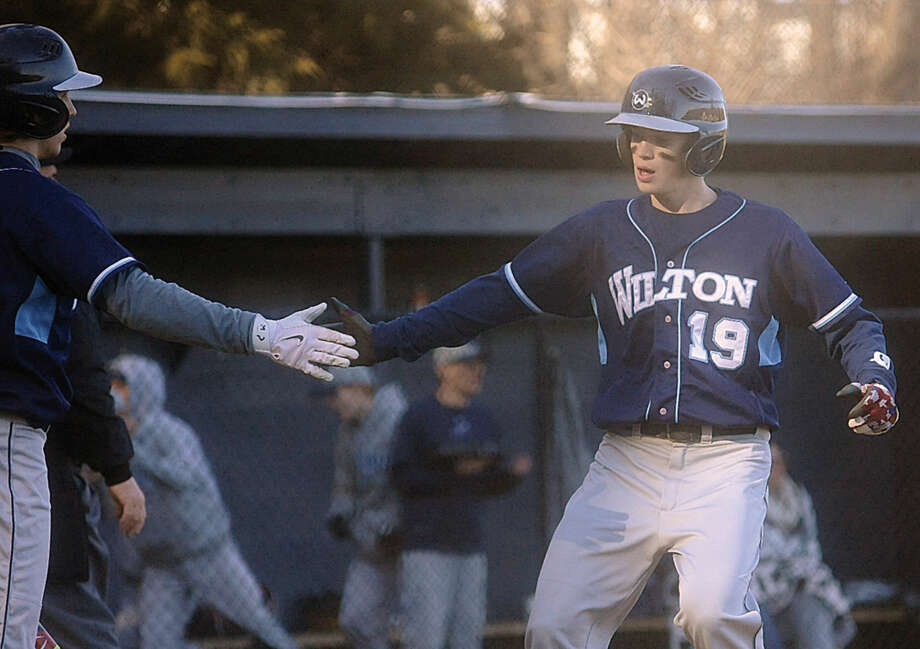 Wilton's Drew Connolly comes in to score the first run of the game.