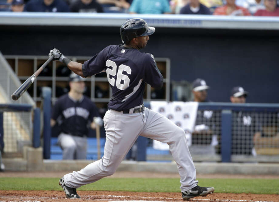 New York Yankees' Eduardo Nunez doubles in the third inning of an exhibition baseball game against the Tampa Bay Rays, Wednesday, March 5, 2014, in Port Charlotte, Fla. (AP Photo/Steven Senne)