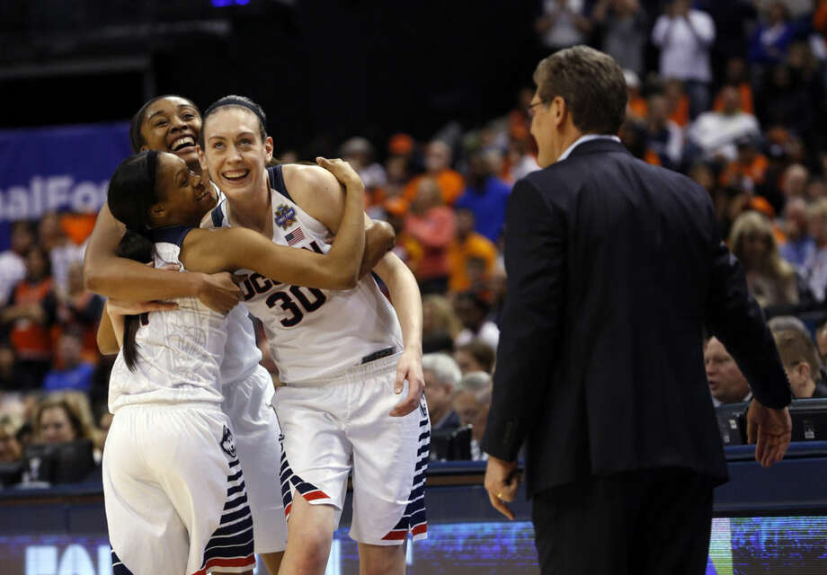 Connecticut's Morgan Tuck, left rear, Moriah Jefferson (4), and Breanna Stewart (30) hug as Connecticut head coach Geno Auriemma watches following the championship game against Syracuse in the women's Final Four in the NCAA college basketball tournament Tuesday, April 5, 2016, in Indianapolis. Connecticut won 82-51. (AP Photo/AJ Mast)