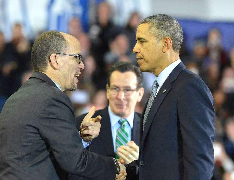 Hour Photo/Alex von Kleydorff . President Obama and U.S. labor Secretary Thomas Perez greet as he heads to the podium at Central Connecticut State University