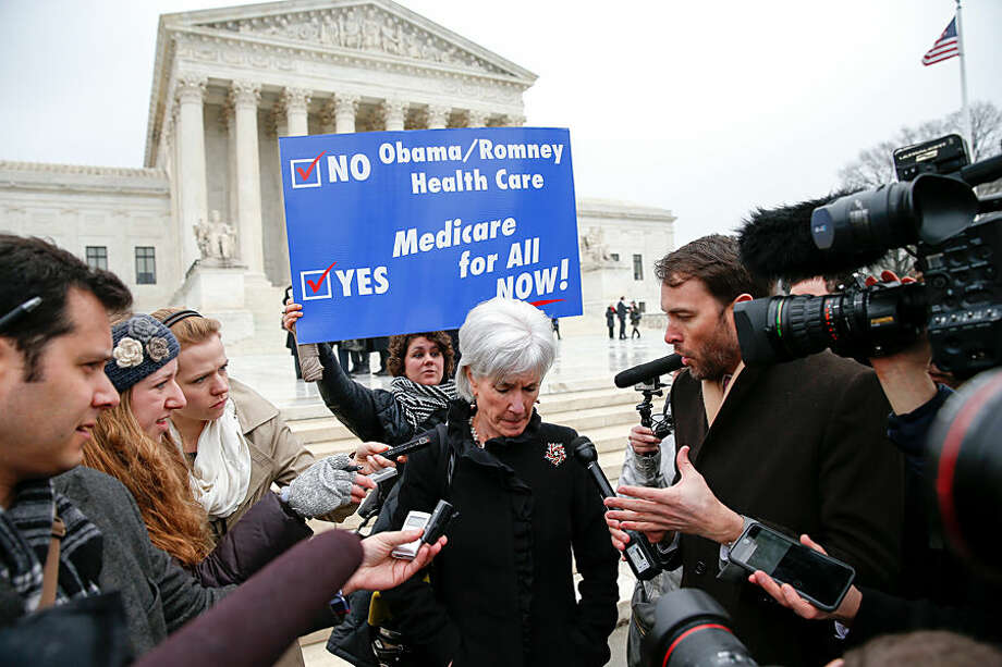Former Health and Human Services Secretary Kathleen Sebelius speaks with reporters outside the Supreme Court in Washington, Wednesday, March 4, 2015. The Supreme Court heard arguments in King v. Burwell, a major test of President Barack Obama's health overhaul which, if successful, could halt health care premium subsidies in all the states where the federal government runs the insurance marketplaces. (AP Photo/Andrew Harnik)