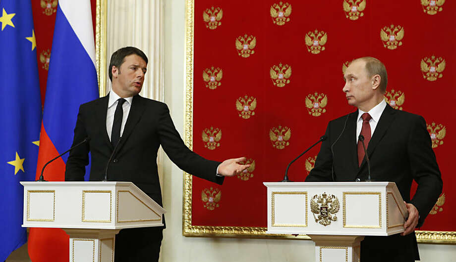 Italian Prime Minister Matteo Renzi , left, speaks as Russian President Vladimir Putin, listens, during their news conference after their talks in the Kremlin in Moscow, Russia, Thursday, March 5, 2015. Italy's prime minister visited Moscow on Thursday in a bid to repair ties that have been hurt by Russia-West tensions over Ukraine. (AP Photo/Sergei Karpukhin, Pool)