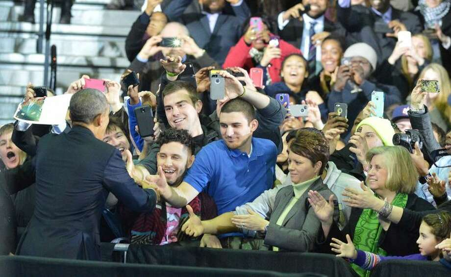 Hour Photo/Alex von Kleydorff President Obama greets some of the CCSU students