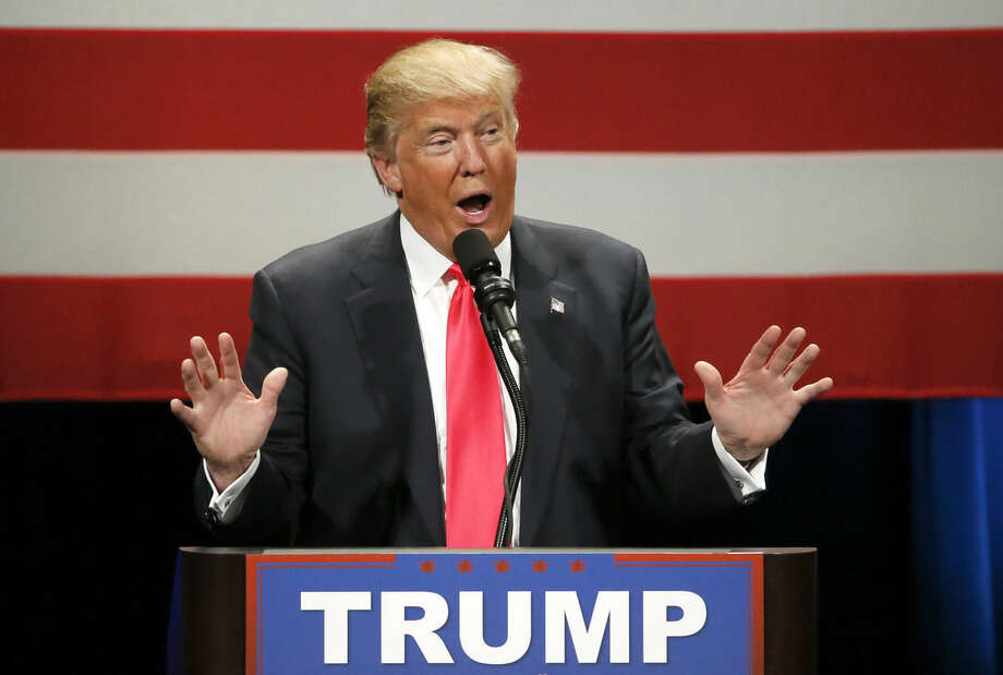 In this April 4, 2016, photo, Republican presidential candidate Donald Trump addresses the crowd during a rally at the Milwaukee Theatre in Milwaukee. He won't be on November's ballot, but President Barack Obama is slowly embracing his role as the anti-Trump, taking on the Republican front-runner in ways that no other Democrat can. (AP Photo/Charles Rex Arbogast)
