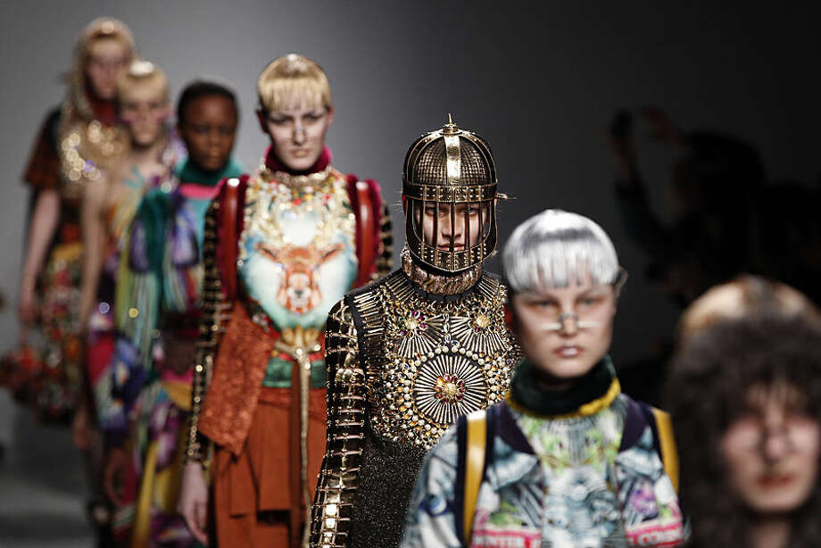 Models wear creations for Indian fashion designer Manish Arora's fall-winter 2015-2016 ready-to-wear fashion collection, as part of the Paris Fashion Week, and presented in Paris, France, Thursday, March 5, 2015. (AP Photo/Christophe Ena)