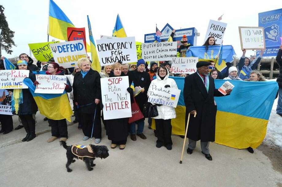 Hour Photo/Alex von Kleydorff People outside Detrick Gym protest for democracy in Ukraine