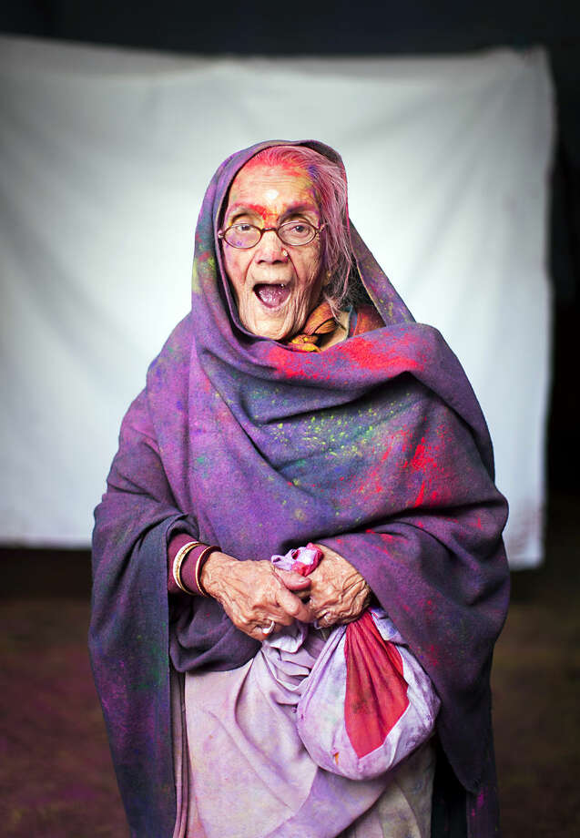 In this March 3, 2015 photo, Hindu widow Vindai Sori, 90, poses for a portrait after celebrating Holi, the Hindu festival of colors, at the Meera Sahabhagini Widow Ashram in Vrindavan, India. Hundreds of widows gathered Tuesday at the Ashram to celebrate the Hindu festival of spring and India's riotous annual celebration of color. (AP Photo/Bernat Armangue)