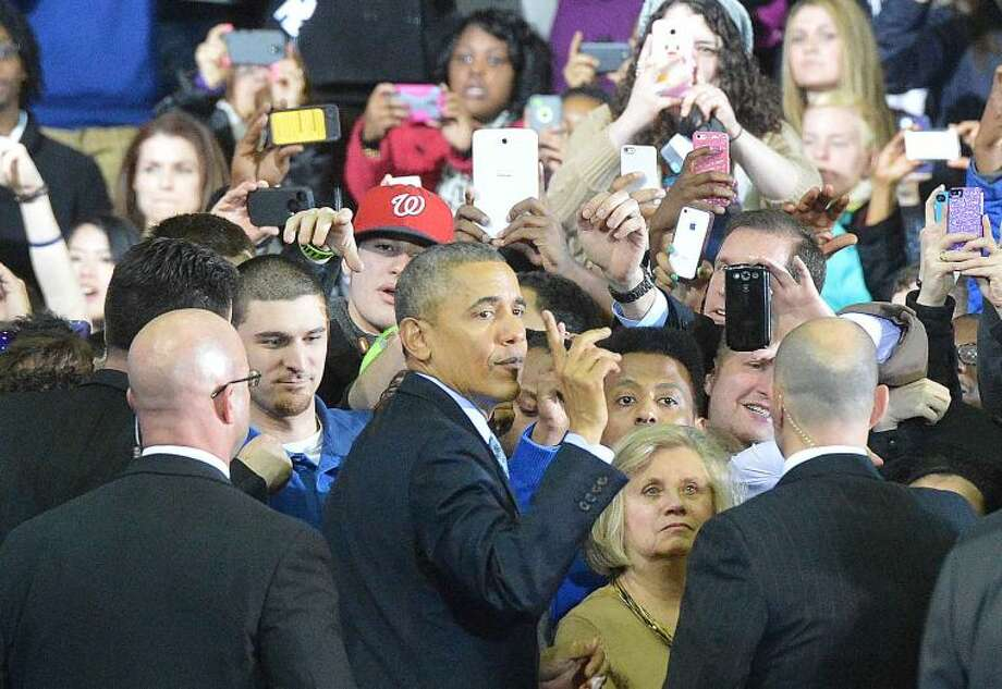 Hour Photo/Alex von Kleydorff President Obama shakes some hands after his speech
