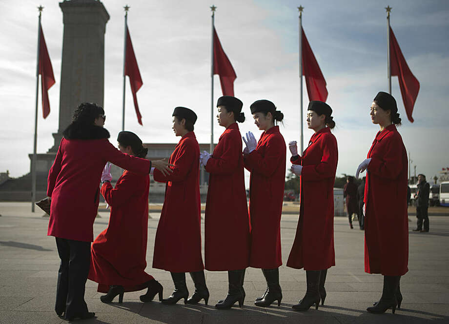 Attendants line up for a group photo on Tiananmen Square in Beijing Wednesday, March 4, 2015. Thousands of delegates from all over the country are in the Chinese capital this week to attend the Chinese People's Political Consultative Conference and the National People's Congress. (AP Photo/Mark Schiefelbein)