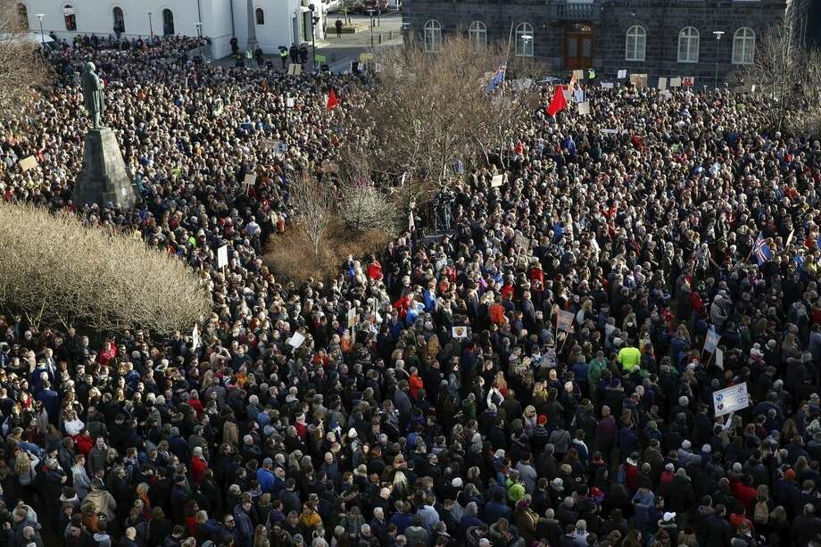 People gather to demonstrate against Iceland's prime minister, in Reykjavik on Monday April 4, 2016. Iceland's prime minister insisted Monday he would not resign after documents leaked in a media investigation allegedly link him to an offshore company that could represent a serious conflict of interest, according to information leaked from a Panamanian law firm at the center of an international tax evasion scheme. (AP Photo/Brynjar Gunnarsson)