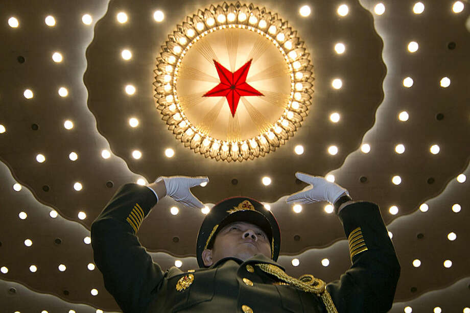 A military band conductor leads during the opening session of the National People's Congress at the Great Hall of the People in Beijing, Thursday, March 5, 2015. (AP Photo/Ng Han Guan)
