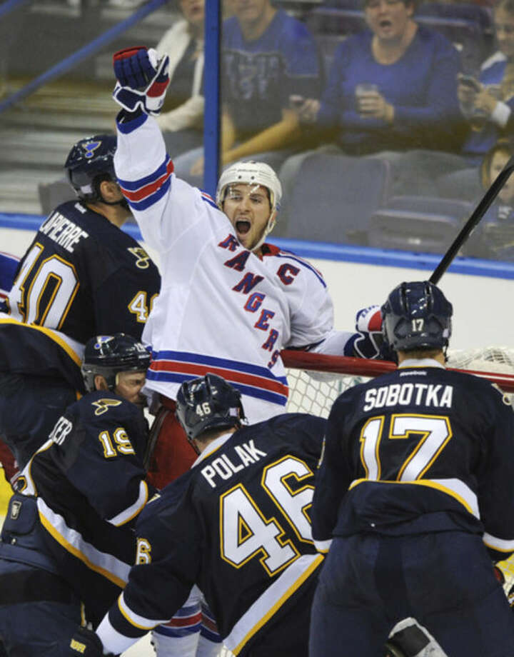 FILE - In this Oct. 12, 2013 file photo, New York Rangers' Ryan Callahan, center, celebrates his goal as St. Louis Blues' Vladimir Sobotka (17), of the Czech Republic, Roman Polak (46), also of the Czech Republic, Jay Bouwmeester (19) and Maxim Lapierre (40) defend during the third period of an NHL hockey game in St. Louis. The Rangers and Tampa Bay Lightning are pulling off the first major deal on NHL trade deadline day, Wednesday, March 5, 2014, swapping captains Ryan Callahan and Martin St. Louis. (AP Photo/Bill Boyce, File)
