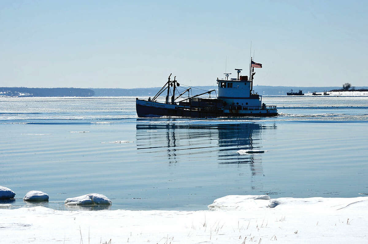 Hour photo / Erik Trautmann Fishing boats take advantage of Friday's thaw by heading out to Norwalk Harbor Friday.