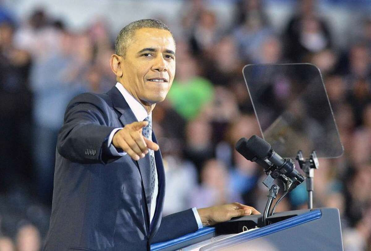 Hour Photo/Alex von Kleydorff. President Barack Obama talks to the crowd at Central Connecticut State University during a speech about raising the Minimum Wage
