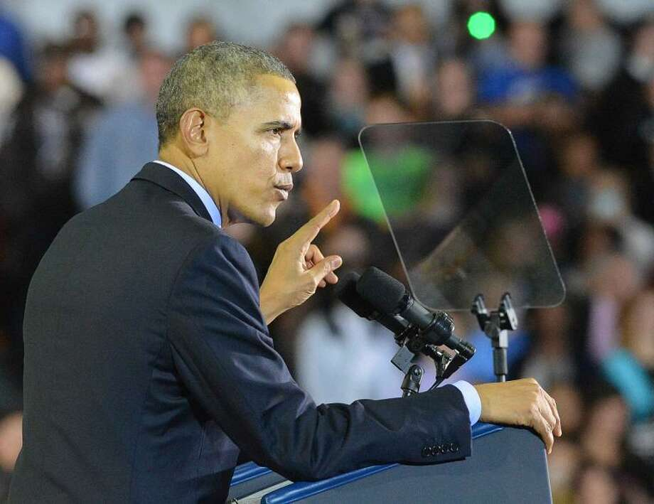Hour Photo/Alex von Kleydorff President Obama makes a point during his speech at Central Connecticut State University
