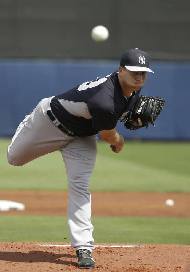 New York Yankees pitcher Adam Warren delivers a warm-up throw in the first inning of an exhibition baseball game against the Tampa Bay Rays, Wednesday, March 5, 2014, in Port Charlotte, Fla. (AP Photo/Steven Senne)