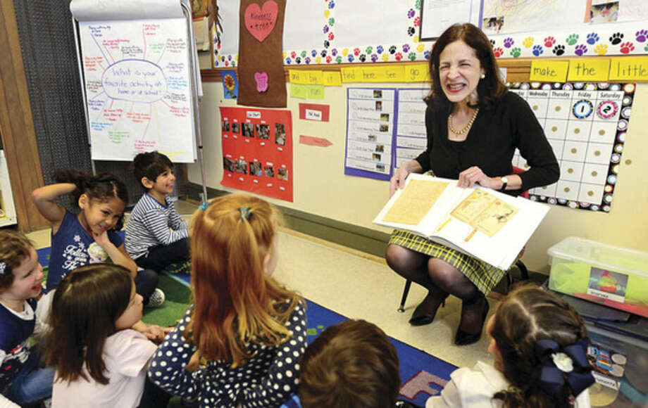 Hour photo/Erik TrautmannState Representative Gail Lavielle (R-143) reads the book, The Day the Crayons Quit, to students at Carousel Preschool Tuesday morning.