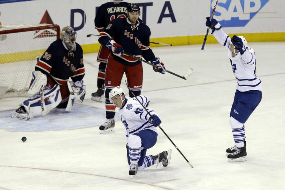 Toronto Maple Leafs' Tyler Bozak (42) celebrates after scoring in overtime of an NHL hockey game against the New York Rangers on Wednesday, March 5, 2014, in New York. The Maple Leafs won 3-2. (AP Photo/Frank Franklin II)