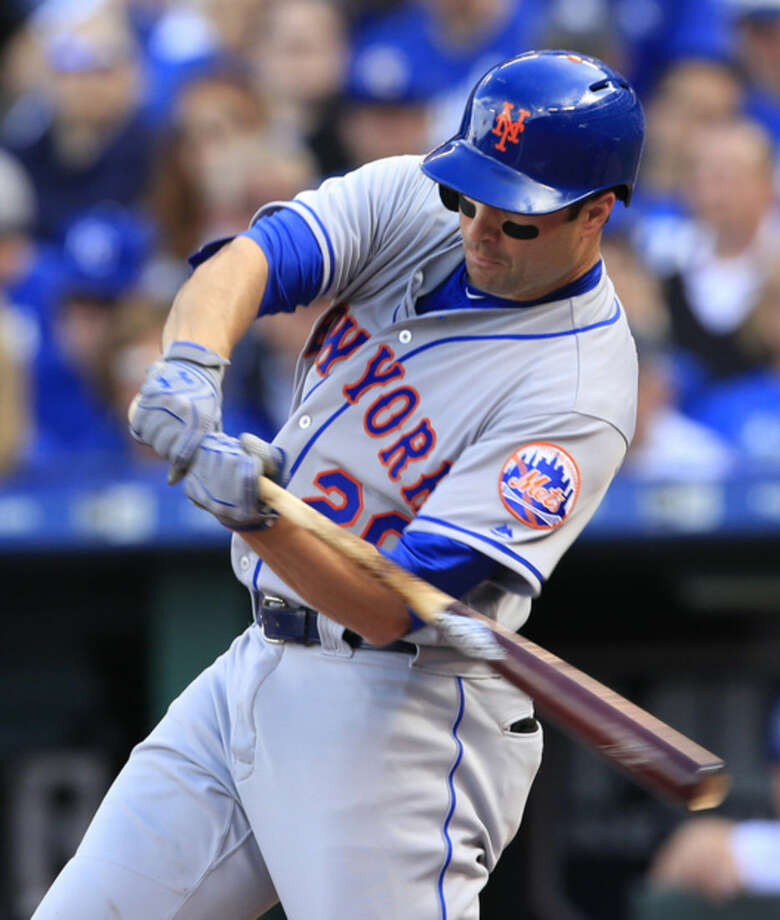 New York Mets' Neil Walker (20) hits a two-run home run off Kansas City Royals starting pitcher Chris Young during the fourth inning of a baseball game at Kauffman Stadium in Kansas City, Mo., Tuesday, April 5, 2016. (AP Photo/Orlin Wagner)