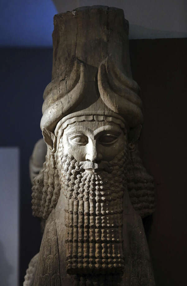 "FILE - This Monday, Sept. 15, 2014 file photo shows a detail of a statue from the Assyrian period displayed at the Iraqi National Museum in Baghdad. Islamic State militants ""bulldozed"" the renowned archaeological site of the ancient city of Nimrud in northern Iraq on Thursday, March 5, 2015 using heavy military vehicles, the government said. Nimrud was the second capital of Assyria, an ancient kingdom that began in about 900 B.C., partially in present-day Iraq, and became a great regional power. The city, which was destroyed in 612 B.C., is located on the Tigris River just south of Iraq's second largest city, Mosul, which was captured by the Islamic State group in June. (AP Photo/Hadi Mizban, File)"