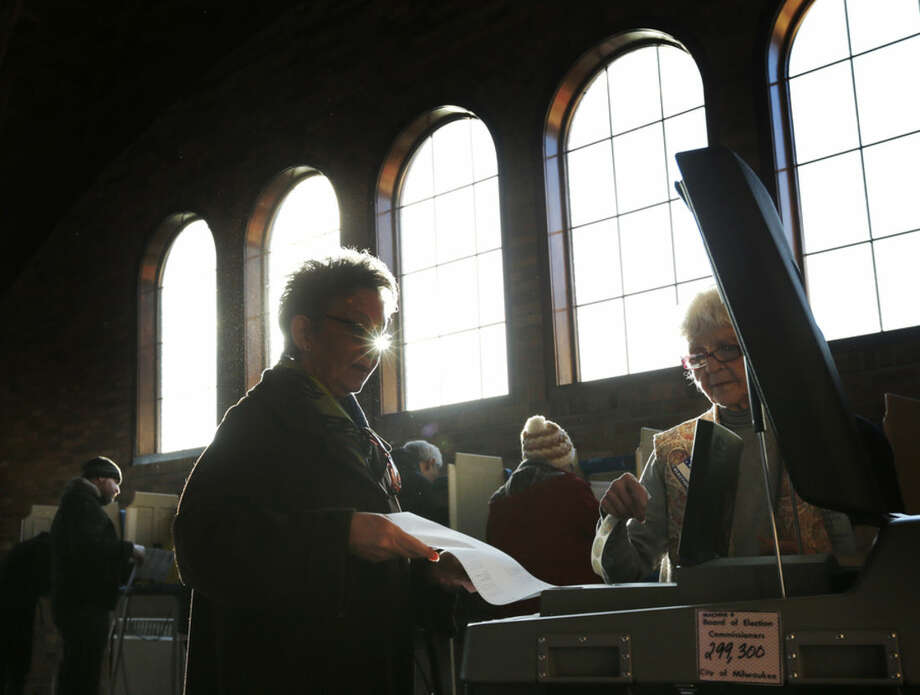 A Wisconsin voter casts her ballot in the state's primary at the South Shore Park Pavilion on Tuesday, April 5, 2016, in Milwaukee. (AP Photo/Charles Rex Arbogast)