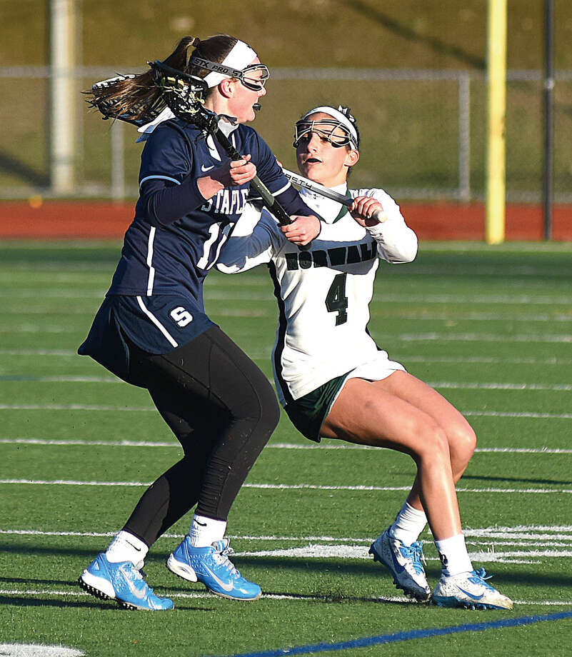 Norwalk's Marissa Mastrianni, right, defends Staples Colleen Bannon during the first half of Tuesday's game at Testa Field in Norwalk.