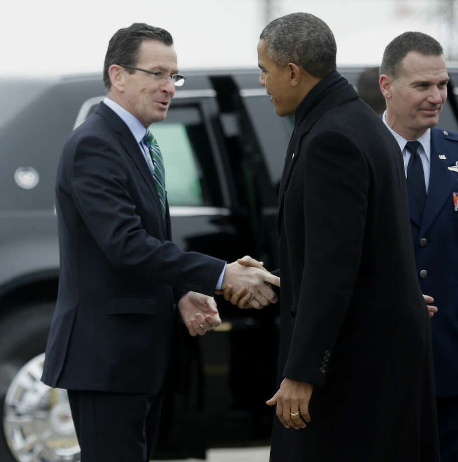 Connecticut Gov. Dannel P. Malloy greets President Barack Obama upon his arrival on Air Force One at Bradley Air National Guard Base in East Granby, Conn., Wednesday, March 5, 2014, before the president traveled to the Hartford, Conn. area to highlight the importance of raising the minimum wage and then will travel to Boston for a pair of Democratic fundraising. (AP Photo/Pablo Martinez Monsivais)