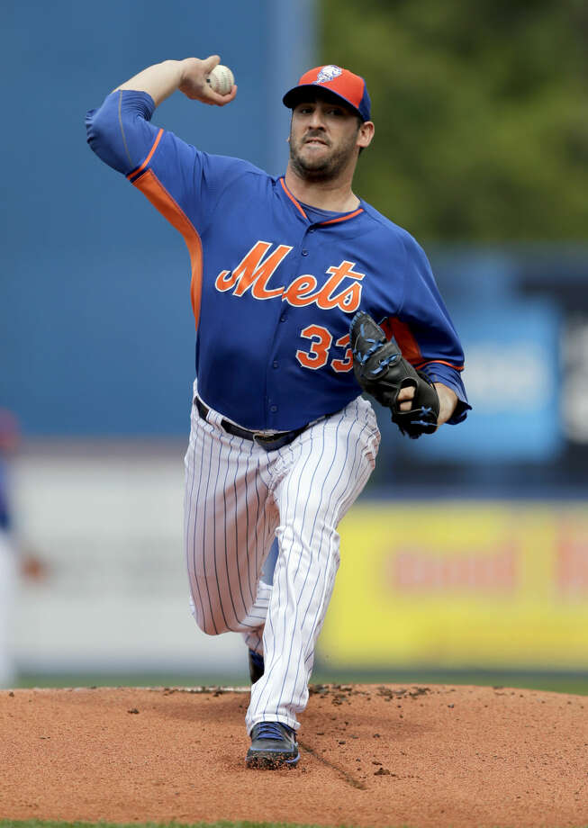 New York Mets starting pitcher Matt Harvey throws his warmup pitches at the start of an exhibition spring training baseball game against the Detroit Tigers Friday, March 6, 2015, in Port St. Lucie, Fla. (AP Photo/Jeff Roberson)