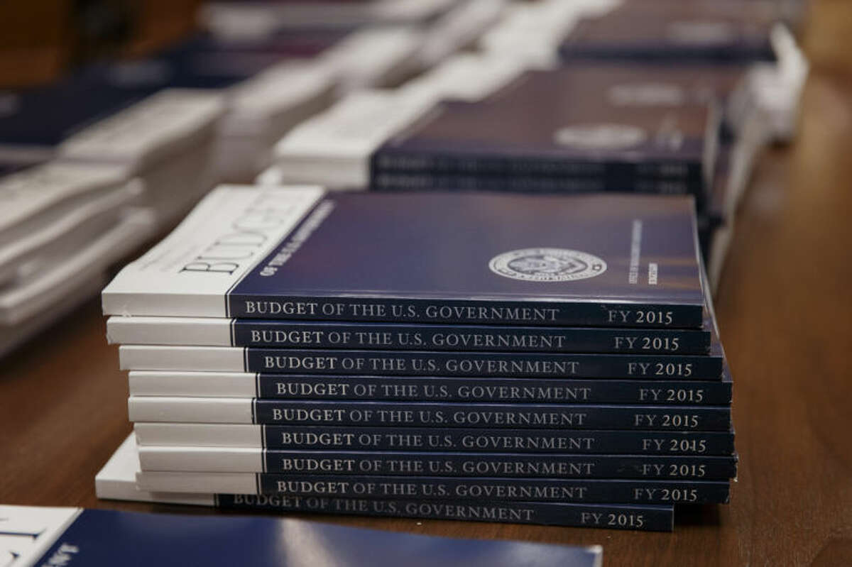 Copies of President Barack Obama?'s proposed budget for fiscal 2015 are set out for distribution by the Senate Budget Committee, on Capitol Hill in Washington, Tuesday, March 4, 2014. (AP Photo/J. Scott Applewhite)