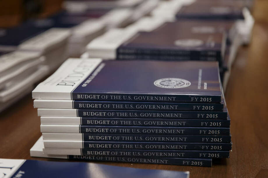 Copies of President Barack Obama's proposed budget for fiscal 2015 are set out for distribution by the Senate Budget Committee, on Capitol Hill in Washington, Tuesday, March 4, 2014. (AP Photo/J. Scott Applewhite)