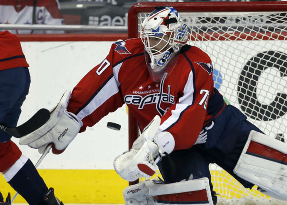 Washington Capitals goalie Braden Holtby (70) catches the puck in the second period of an NHL hockey game against the New York Islanders, Tuesday, April 5, 2016, in Washington. (AP Photo/Alex Brandon)